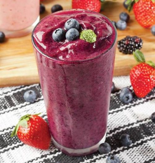 Healthy hair recipe Pretty Potion Smoothie by Joy Bauer dark pink berry smoothie in glass black white tablecloth strawberries blueberries healthy hair growth smoothies viviscal hair blog