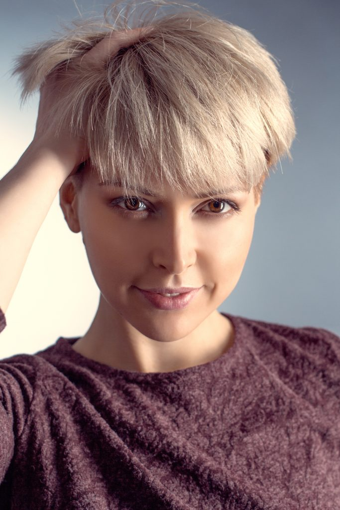 pixie cut blonde woman closeup short hairstyle what your hair says about you viviscal hair blog