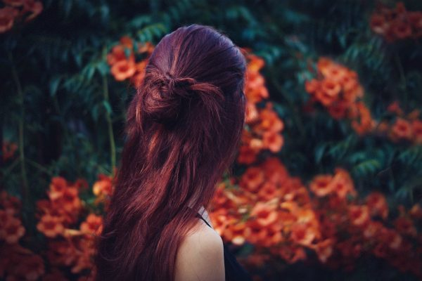 red hair woman half up half down updo hairstyle for thin hair