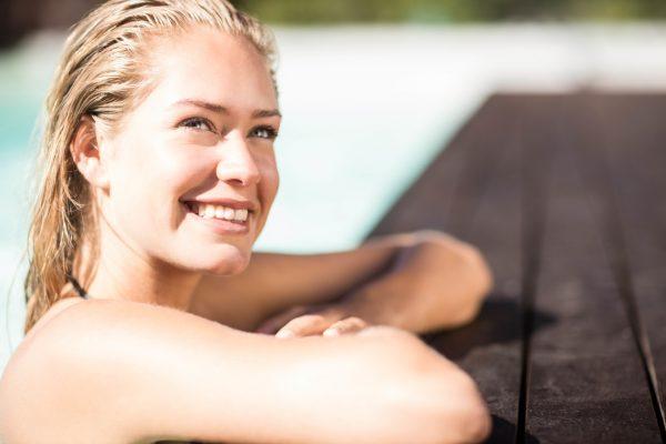 Smiling-blonde-woman-swimming-pool-chlorine-damage-swimmer-hair-Viviscal