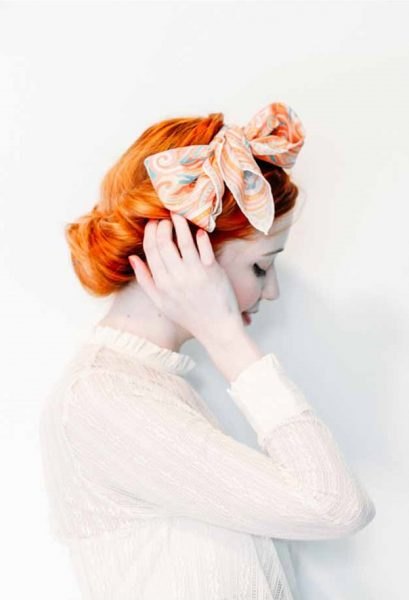 redhead scarf low chignon twist retro best simple hairstyles long hair viviscal blog