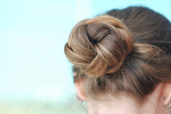 low braided bun woman back best simple hairstyles long hair viviscal blog
