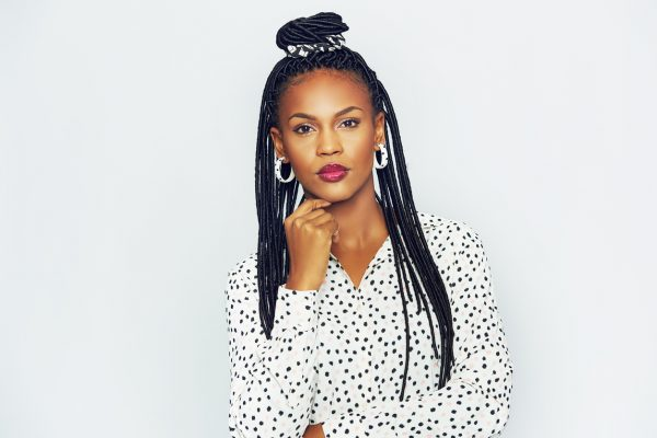 black woman long braids half bun hairstyle best simple hairstyles long hair viviscal blog