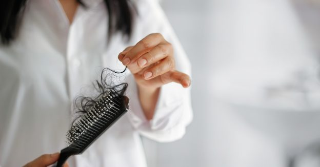 hair-loss-hairbrush-woman-Viviscal-causes-patchy-hair-loss
