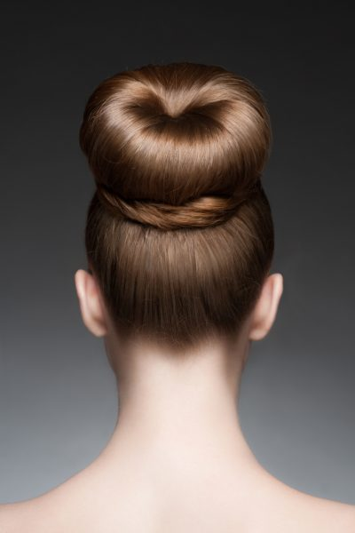 woman back thick elegant classic chignon hairstyle best formal hairstyles viviscal blog