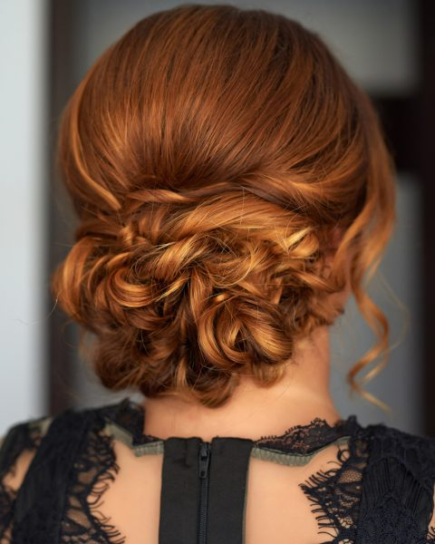 low messy bun curls redhead best formal hairstyles viviscal blog