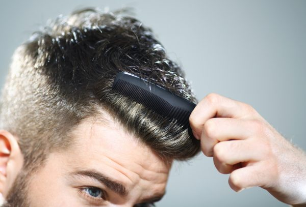 man combing hair closeup hairline top hair styling product men viviscal hair blog