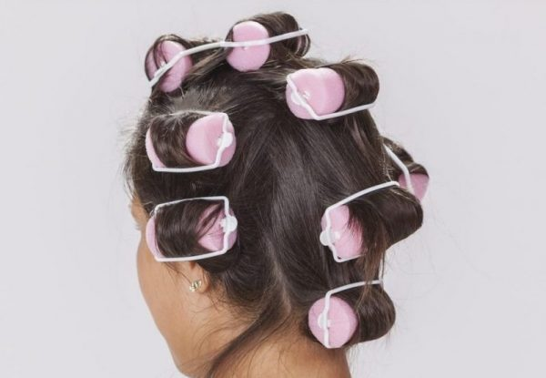 Brunette woman back foam curlers getting perfect no-heat curls