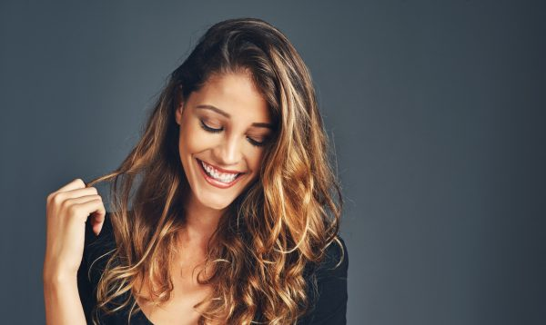 Happy smiling woman beachy waves long hair no heat curls viviscal hair blog