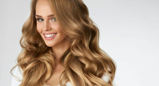 woman long curly shiny blonde hair top tips fixing dull hair viviscal hair blog