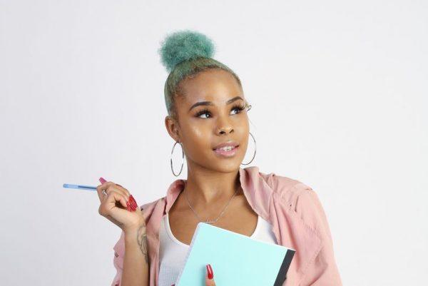 green blue topknot hair bun woman temporary hair color viviscal hair blog