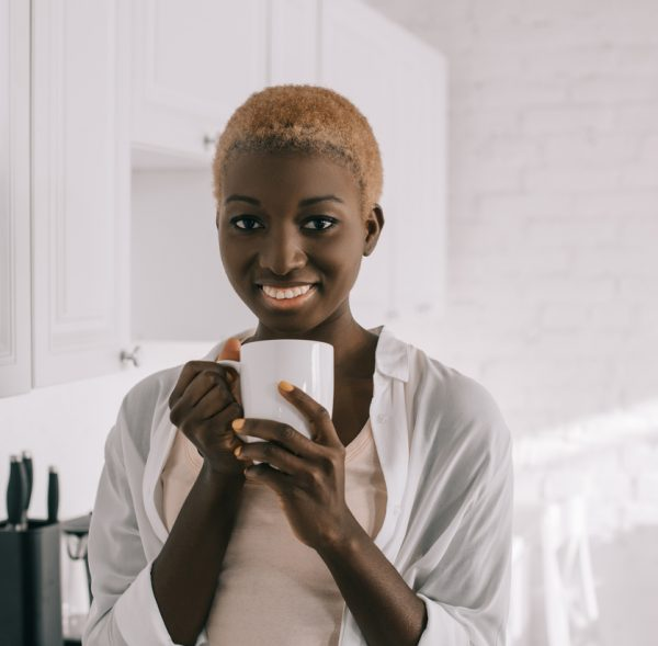 buzz short hair cut african american woman cheerful coffee 2019 hairstyles for women viviscal hair blog