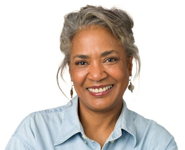 aging hair smiling african american woman viviscal hair blog