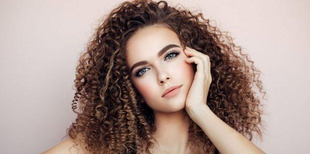 curly hair woman beautiful studio how to tame frizzy hair viviscal hair blog
