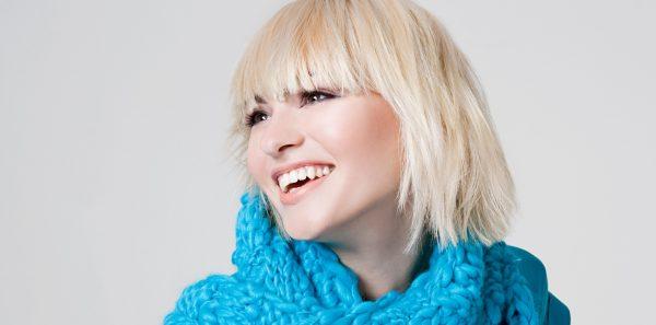 shaggy bob bangs blonde woman blue scarf 2019 hairstyles women viviscal hair blog