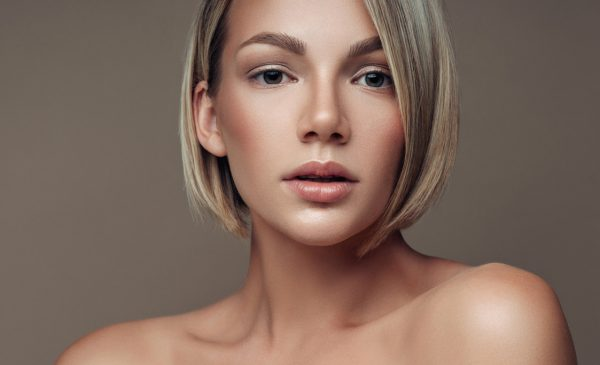 blonde woman blunt short cut oval faces choosing a hairstyle for your face shape viviscal hair blog
