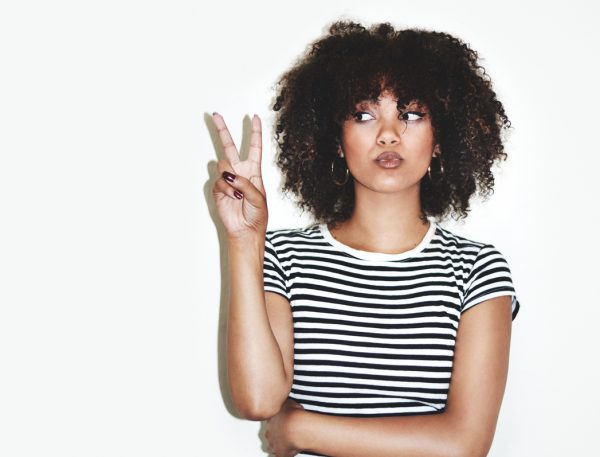 african american woman peace sign striped shirt curly natural hair what is my hair type viviscal hair blog