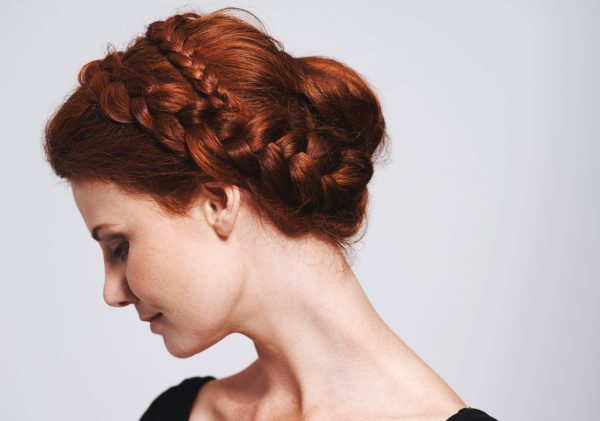 redhead woman side braided updo messy dutch braids ranking our favorite red carpet hairstyles viviscal hair blog