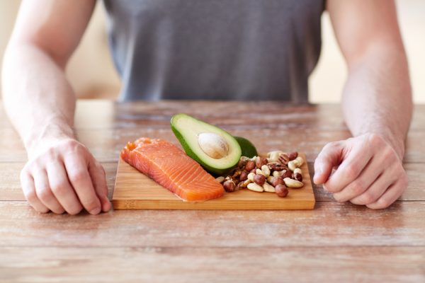 man counter top salmon avocado nuts healthy foods hair growth summer hair care tips viviscal hair blog