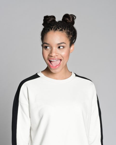 happy african american woman space buns hairstyle our favorite heatless hairstyles viviscal hair blog