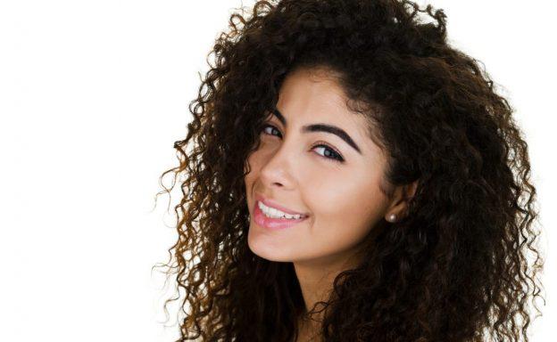 woman dark curly hair tips for perfect wet curls viviscal hair blog