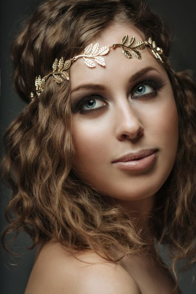 woman closeup golden grecian halo headband adding to a look with hair styling accessories viviscal hair blog