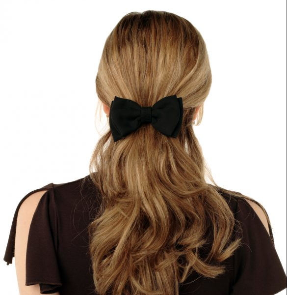 blonde woman long hair black hair bow adding to a look with hair styling accessories viviscal hair blog