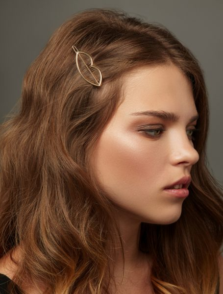 red hair woman side view gold statement barrette adding to a look with hair styling accessories viviscal hair blog