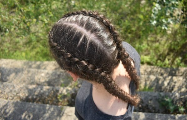 From above, brown hair double dutch braids outside. Our favorite festival hairstyle ideas viviscal hair blog