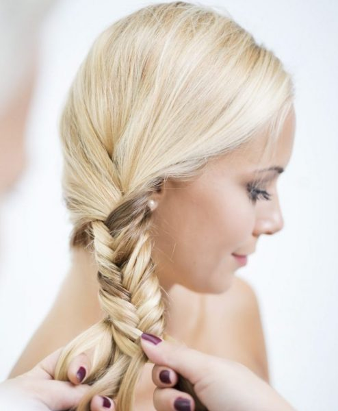 blonde fishtail braid side woman cute back to college hairstyles viviscal hair blog