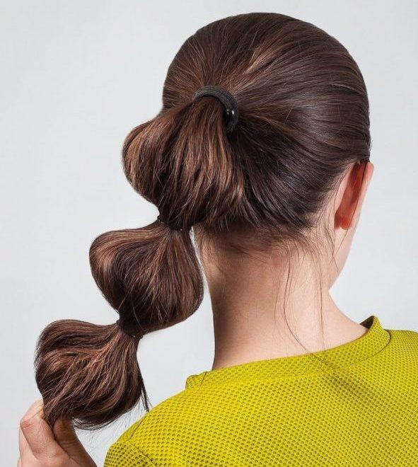 back hair woman bubble ponytail green shirt brown hair our favorite festival hairstyles viviscal hair blog