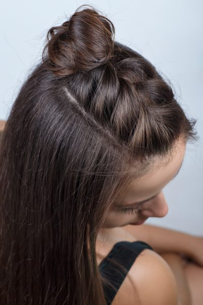 half up Mohawk braid hairstyle on a woman with long brown hair. Favorite festival hairstyle ideas viviscal hair blog