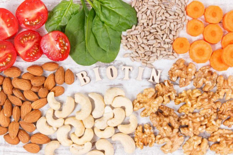 healthy foods rich in biotin (vitamin B7) vegetables nuts white background