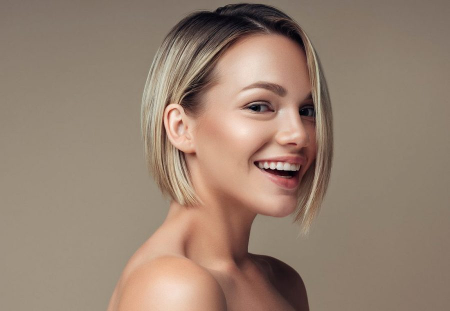 smiling blonde woman side classic chin length bob how to wear and style chin length bobs viviscal hair blog