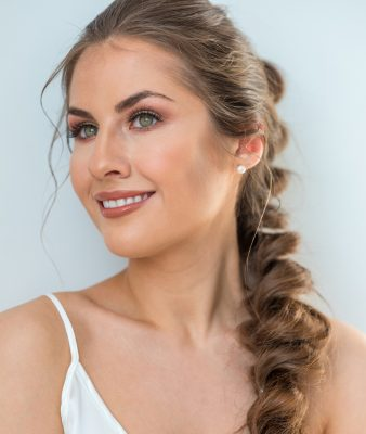 smiling woman long rumpled loose braid hairstyle holiday hair ideas for 2019 viviscal hair blog