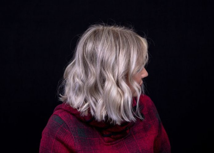woman side platinum wavy bob black background how to wear and style bobs viviscal hair blog