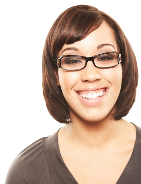 Woman with side bangs, a bob and glasses smiles