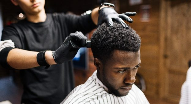 african american man barber shop salon getting haircut how often should males get a haircut? viviscal hair blog
