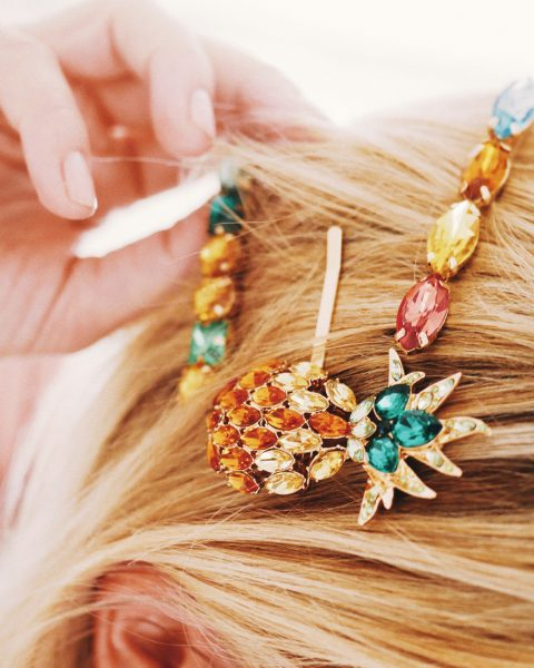 closeup jeweled colored barrettes blonde hair pineapple the big hair clip trend for thin hair viviscal hair blog