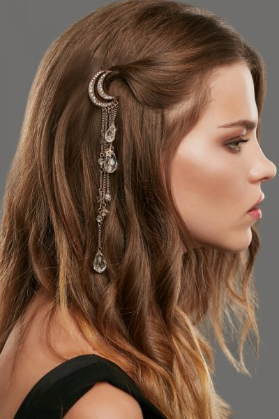 side view young woman crystal fringe barrette the big hair trend for thin hair viviscal hair blog