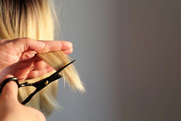 closeup trimming ends blonde hair scissors haircut how to fix bleach damaged hair viviscal hair blog