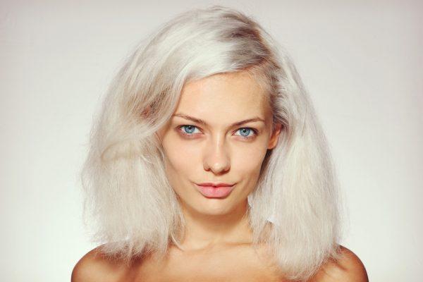 woman dry damaged bleached hair how to fix bleach damaged hair viviscal hair blog