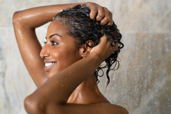 Woman bathing and washing hair Viviscal Blog