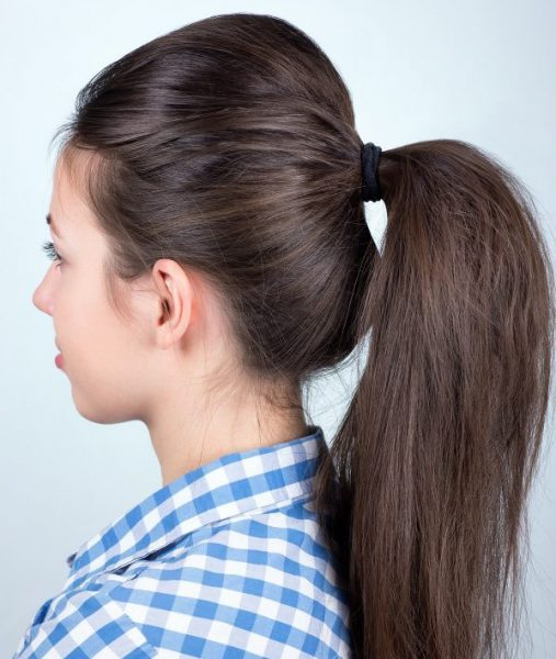 ponytail woman dark brown hair blue white checked shirt backcombed volume how to get a voluminous ponytail viviscal hair blog