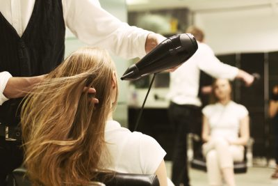 Stylist Drying Girl's Hair With babylights andHair Dryer In Beauty Salon Viviscal Blog